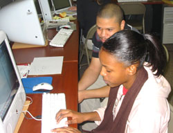 Staff member Ismael Torres mentors a beginning apprentice in fall 2006.